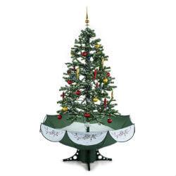 Schneiender Weihnachtsbaum in grün mit weißenm Schnee